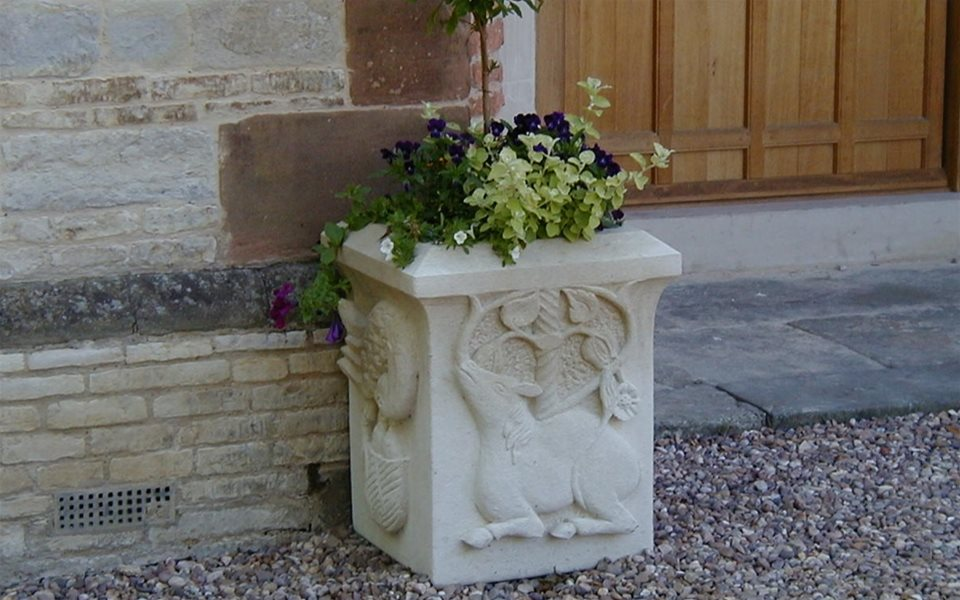 One of a set of four stone planters